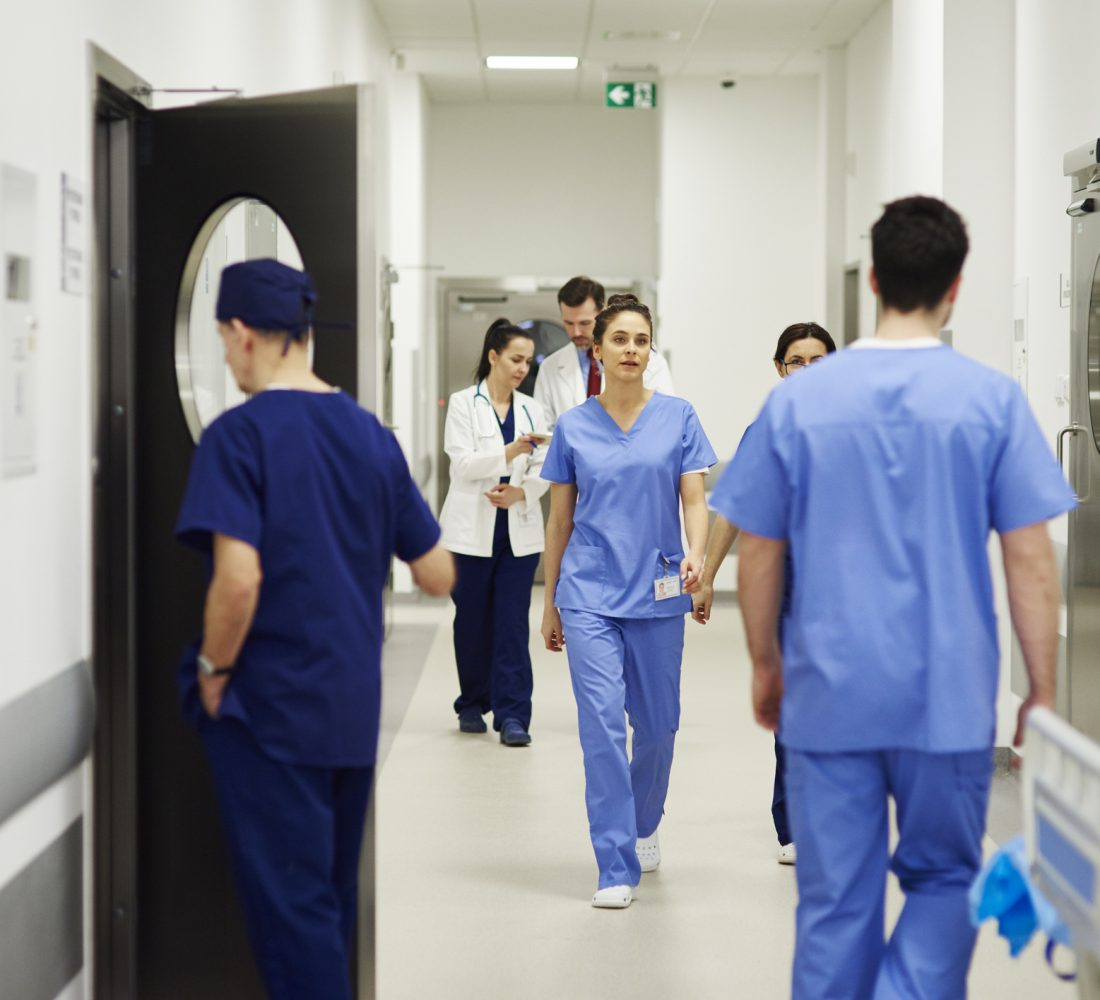 Doctors walking through corridor in hospital